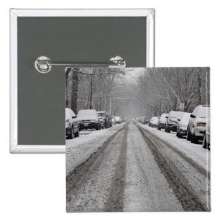 Wide view of unplowed snow covered street in 15 cm square badge