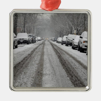 Wide view of unplowed snow covered street in christmas ornament