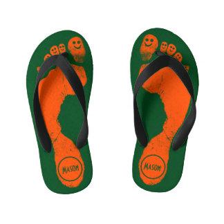 Wild Orange Footprints Smiley-Toes™ on Grass Green Flip Flops