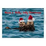 Wildlife Christmas Card, Otters Wearing Santa Hats