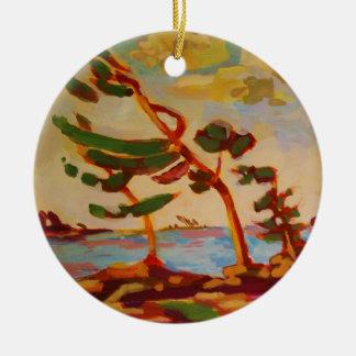 Wind-swept trees round ceramic decoration