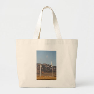 Wind Turbines With A Full Moon Portrait Canvas Bags