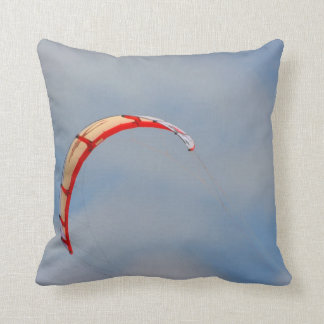 Windboard red sail against blue sky cushion