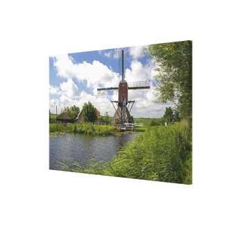 Windmill along a canal east of Leiden in the Stretched Canvas Print