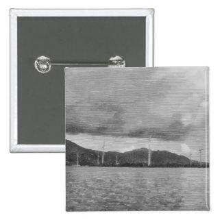 Windmills along the shore 15 cm square badge