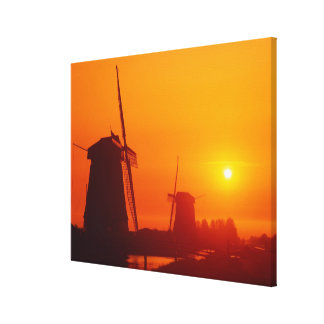 Windmills at sunset, Schermerhorn, Netherlands Canvas Print