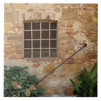 Window and ancient stone wall, Pienza, Italy Tile
