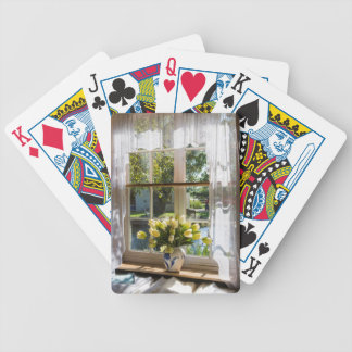 Window with lace curtain and tulips bicycle playing cards