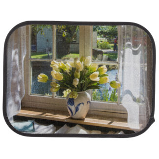 Window with lace curtain and tulips car mat