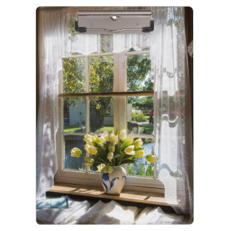 Window with lace curtain and tulips clipboard