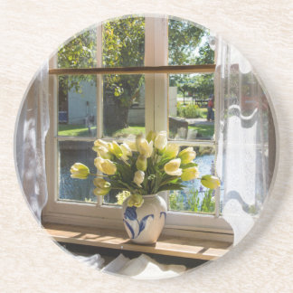 Window with lace curtain and tulips coaster