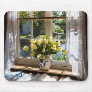 Window with lace curtain and tulips mouse pad