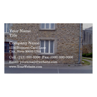 Windows In Rough Stone Wall House With Lace Curtai Business Card Templates