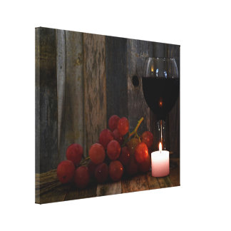 wine and grapes in candle glow canvas print
