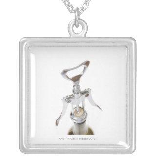 Wine bottle with corkscrew. square pendant necklace