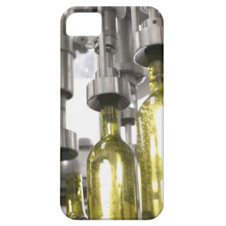 wine bottles being filled with wine at factory iPhone 5 cover