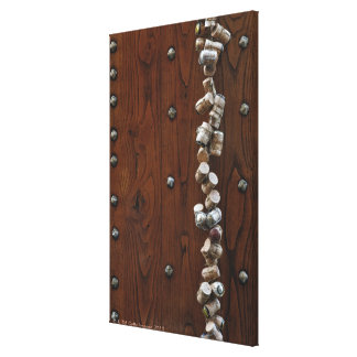 Wine corks hanging on wooden door canvas print