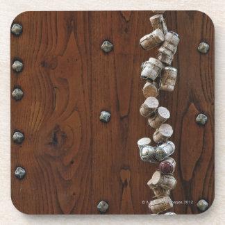 Wine corks hanging on wooden door coaster