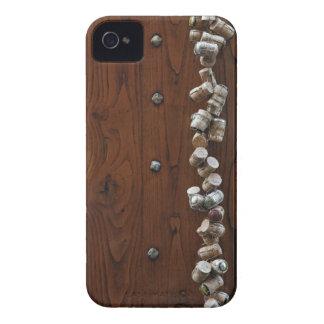 Wine corks hanging on wooden door iPhone 4 cover