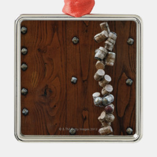 Wine corks hanging on wooden door Silver-Colored square decoration