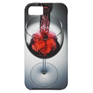 Wine poured in glass case for the iPhone 5