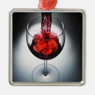 Wine poured in glass christmas ornament