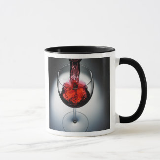 Wine poured in glass mug