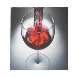 Wine poured in glass notepad