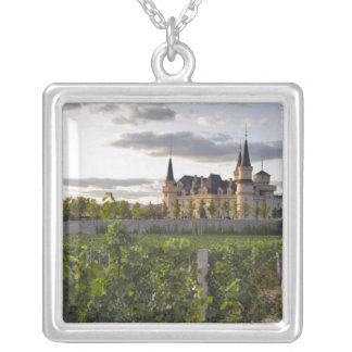 Winery building seen from the vineyard at silver plated necklace