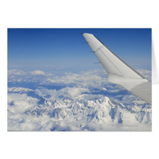 Wings of flying airplane over French Alps, Card