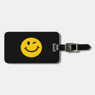 Winking smiley face luggage tag