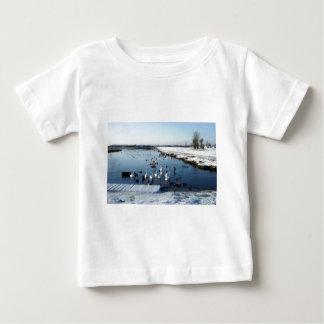 Winter boating lake scene with birds feeding. baby T-Shirt