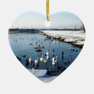Winter boating lake scene with birds feeding. ceramic heart decoration