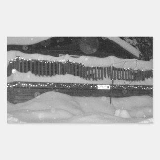 winter cabin snow dripping off the deck rectangular sticker
