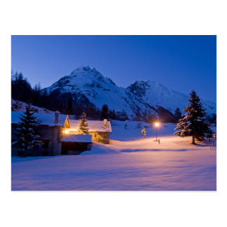 Winter chalets sunrise postcard