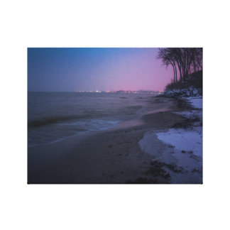 Winter dusk on the beach canvas print