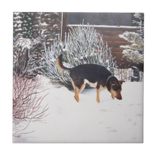 Winter snow scene with cute black and tan dog tiles
