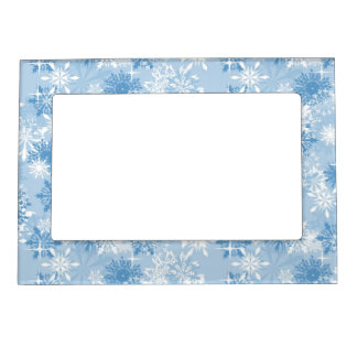 Winter snowflakes pattern on blue magnetic frame