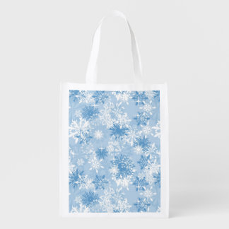 Winter snowflakes pattern on blue reusable grocery bag