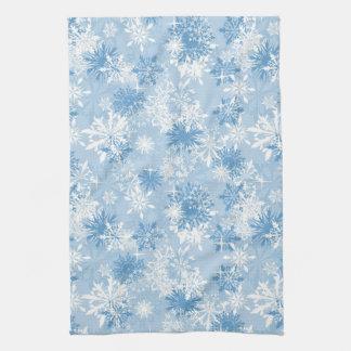Winter snowflakes pattern on blue tea towel
