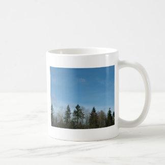 winter trees and blue sky basic white mug