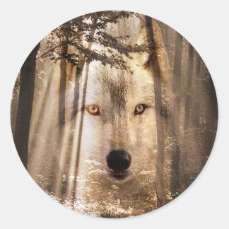 Wolf face in woods round sticker