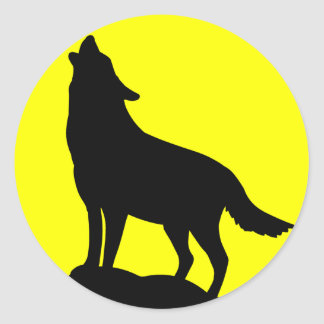 Wolf Howling at the Moon. Round Sticker