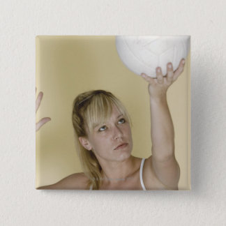 Woman about to serve volleyball 15 cm square badge