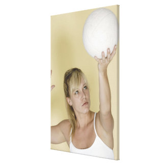 Woman about to serve volleyball canvas print