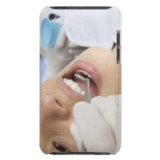 Woman, aged 27, being examined in a dentists iPod touch cover