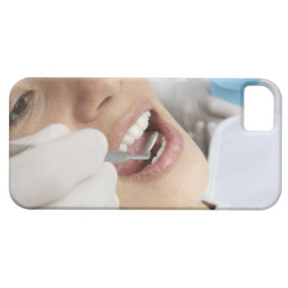 Woman, aged 27, being examined in a dentists case for the iPhone 5