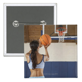 Woman aiming at hoop with basketball, rear view 15 cm square badge