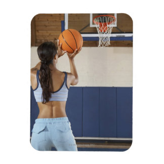 Woman aiming at hoop with basketball, rear view vinyl magnets