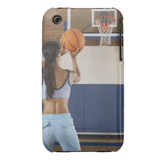 Woman aiming at hoop with basketball, rear view iPhone 3 case